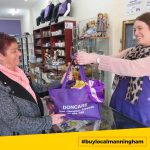 Lady being served by shopkeeper at Doncare op Shop #buylocalmanningham