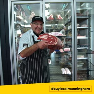 Butcher holding up meat at DiCenso Butchers #buylocalmanningham