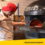 Male staff cooking pizza at pizza oven at Zero 95 #buylocalmanningham